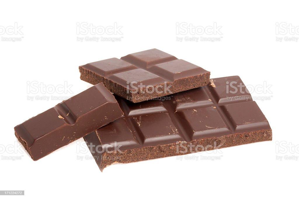 Bars of dark chocolate on white background royalty-free stock photo