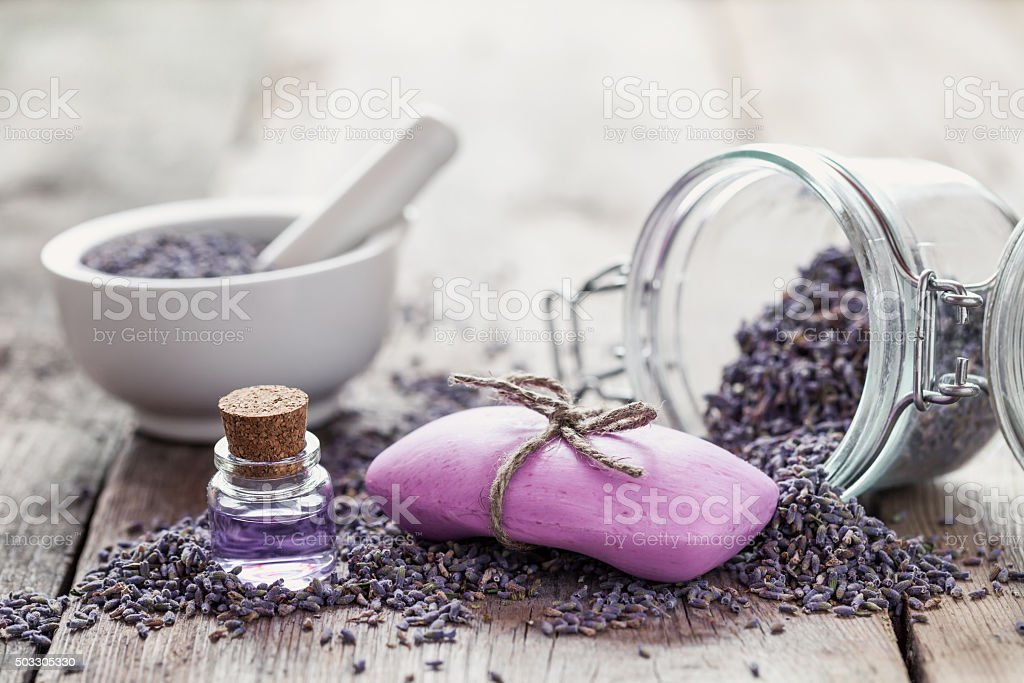 Bars of homemade soaps, dry lavender flowers and essential oil. stock photo
