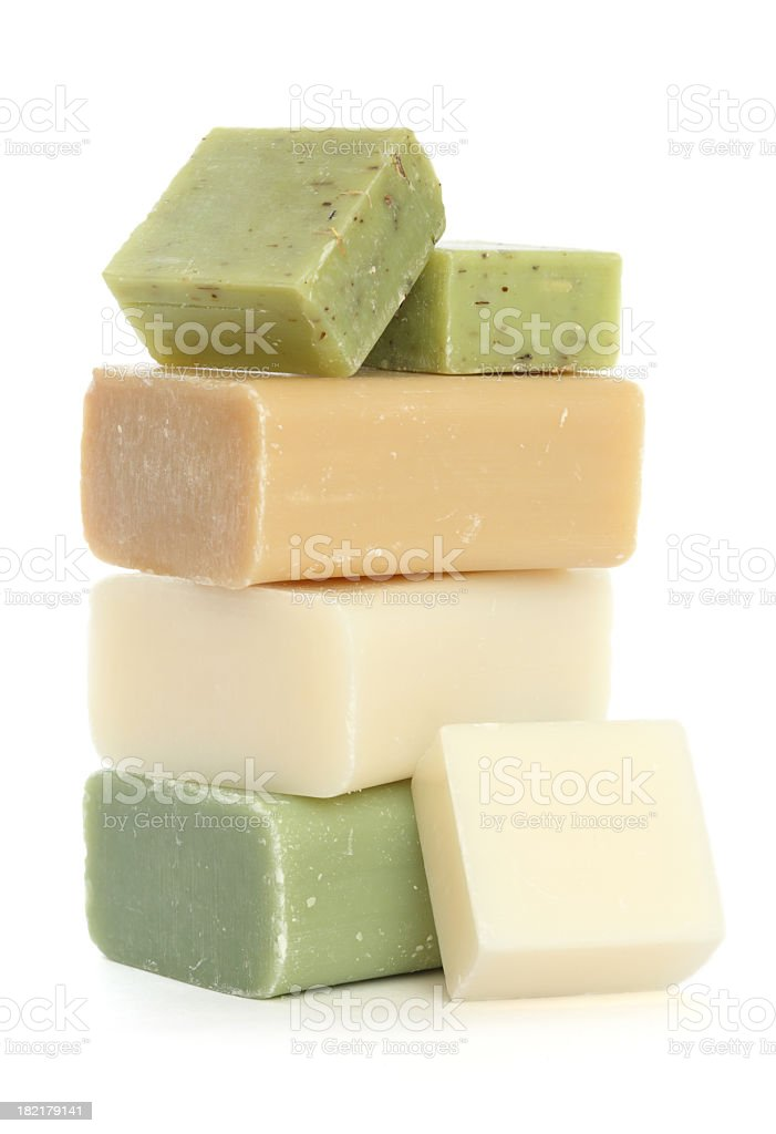 Bars of soap stacked on a white background stock photo