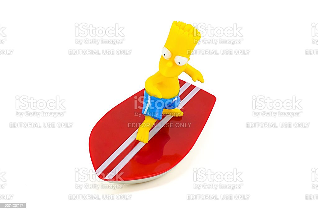 Bart Simpson standing on surfboard figure toy character from The stock photo