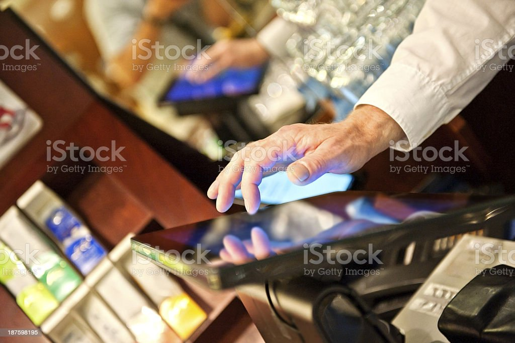 Bartender at the point of sale terminal stock photo
