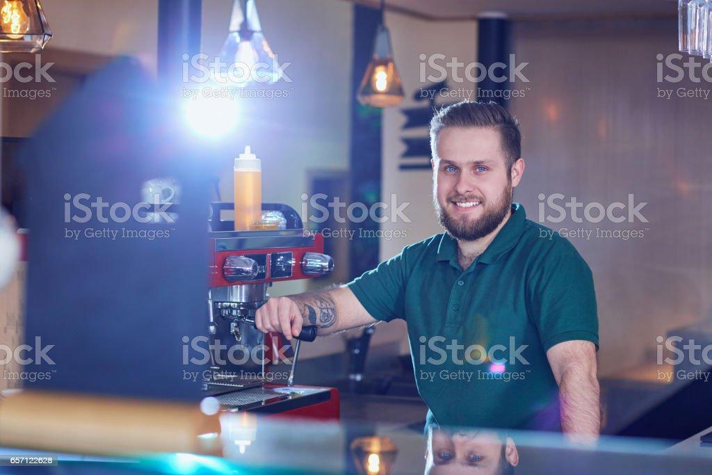 Bartender barista  behind the bar at the break stock photo