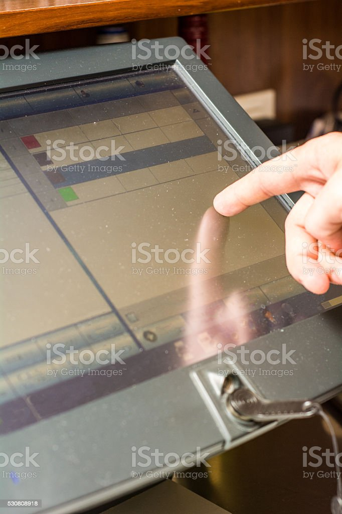 Bartender behind the cashier counter stock photo