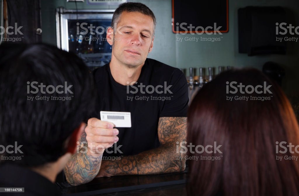Bartender Checking ID stock photo