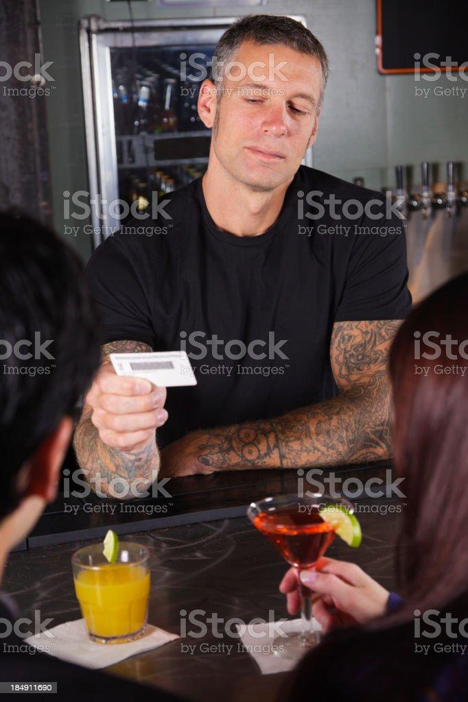 Bartender Checking ID stock photo