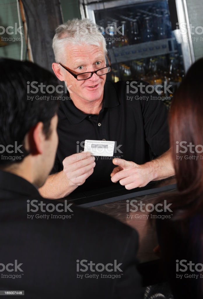Bartender Checking ID royalty-free stock photo