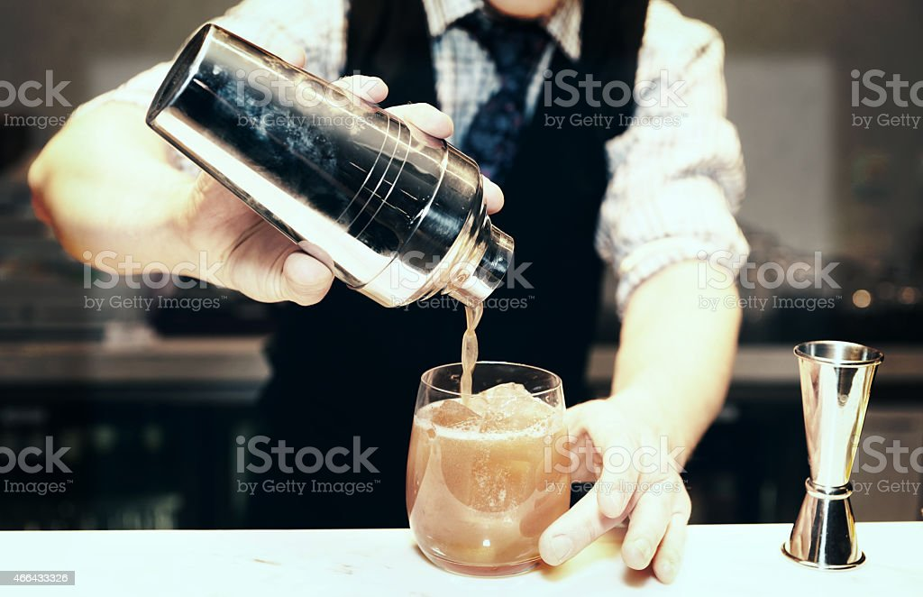 Bartender is making a cocktail stock photo