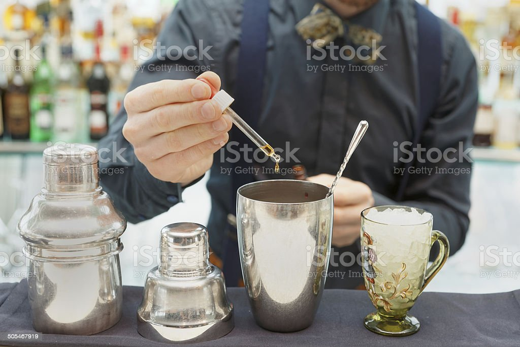 Bartender is making cocktail at bar counter stock photo