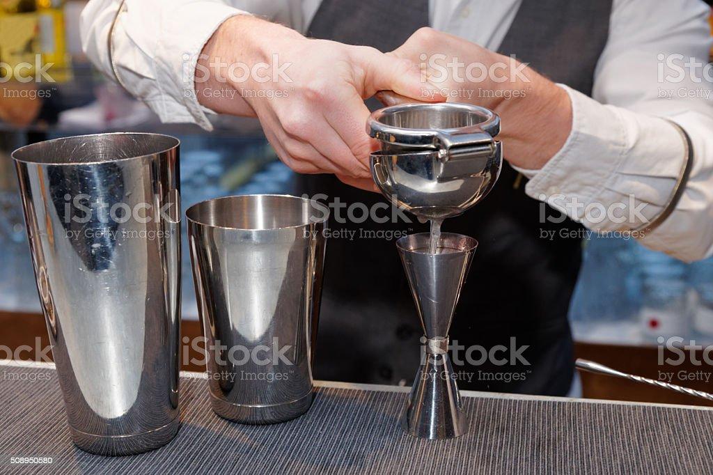 Bartender is squeezing citrus juice stock photo