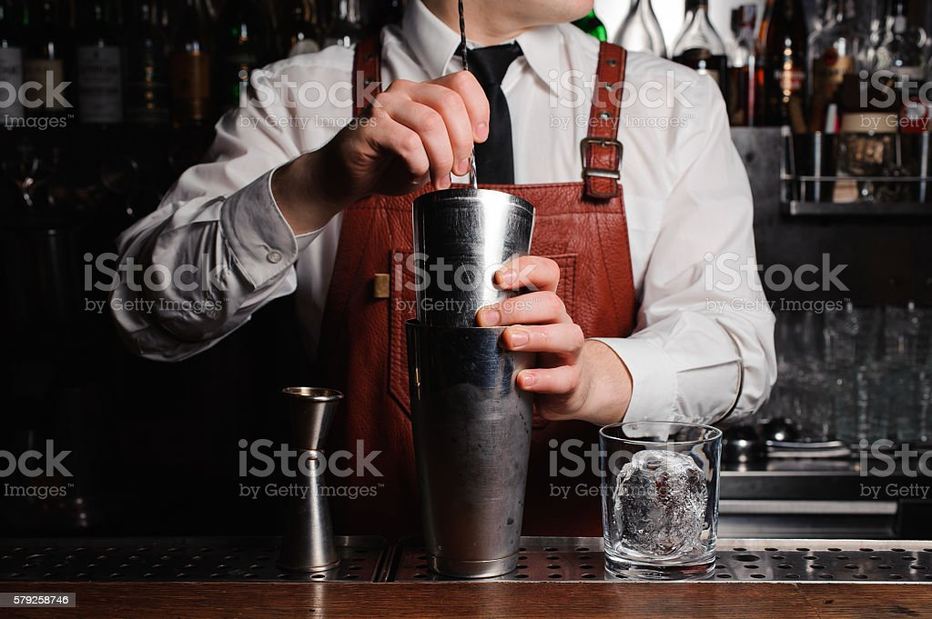 Bartender is stirring cocktails on the bar counter stock photo