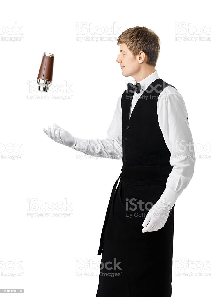 Bartender juggling with shaker and making cocktail stock photo