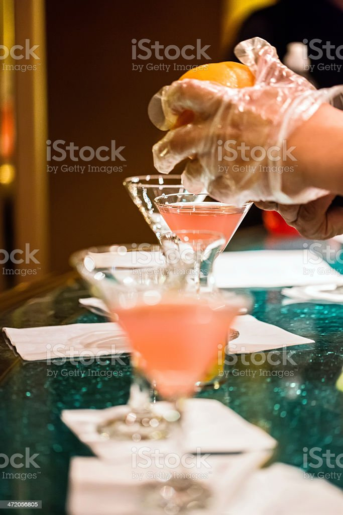 Bartender making specialty alcoholic martini at bar royalty-free stock photo