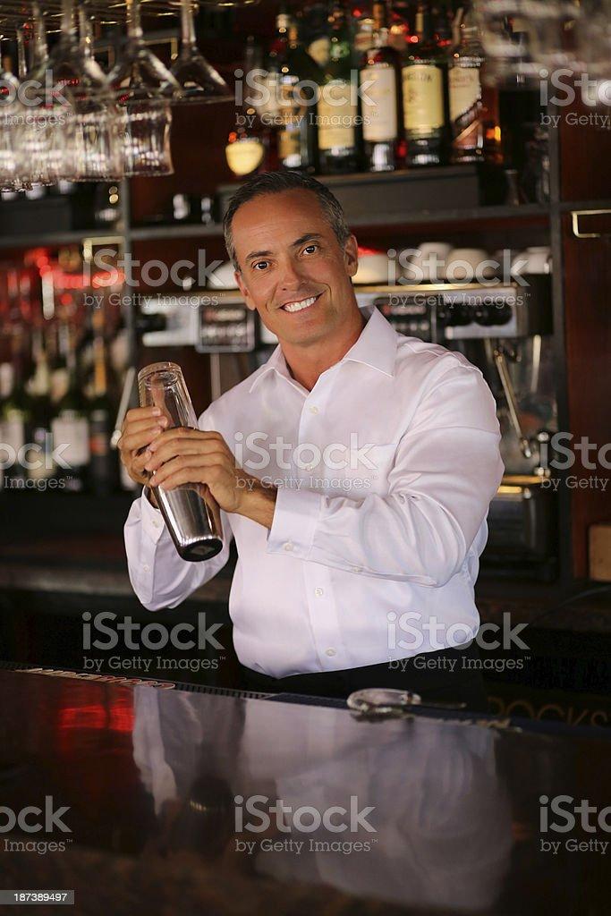 Bartender Mixing Drinks At Bar royalty-free stock photo