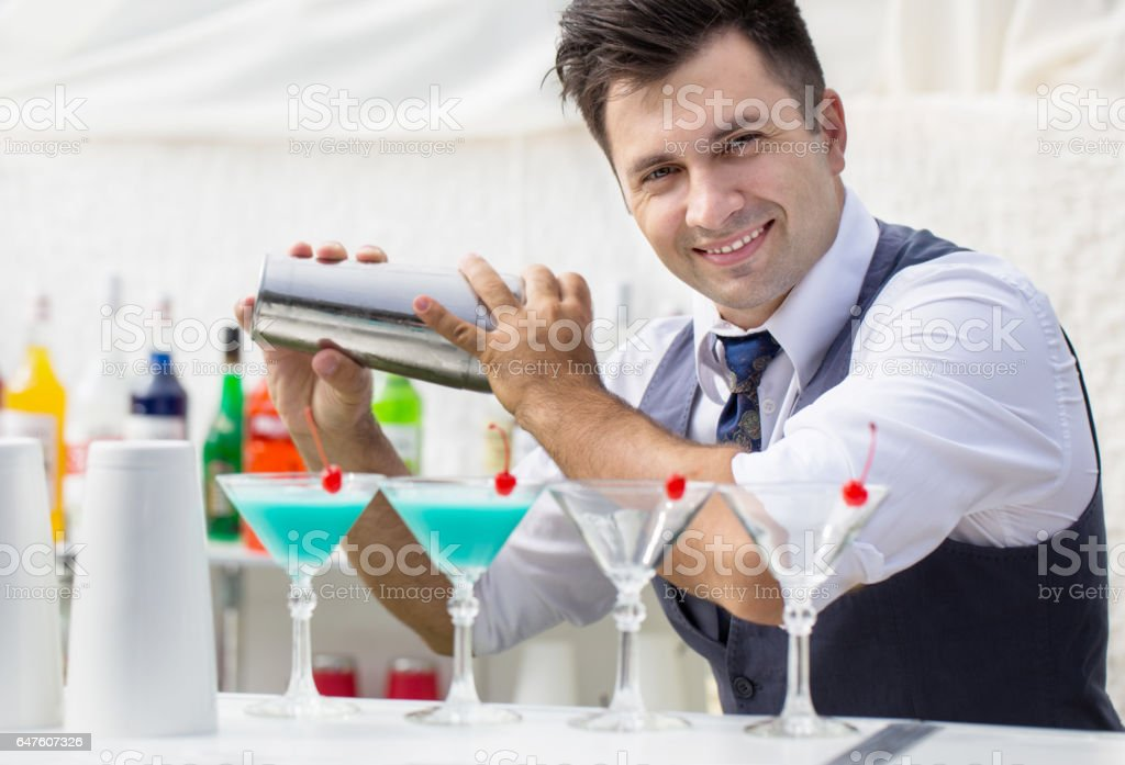 bartender pouring a cocktail drink stock photo