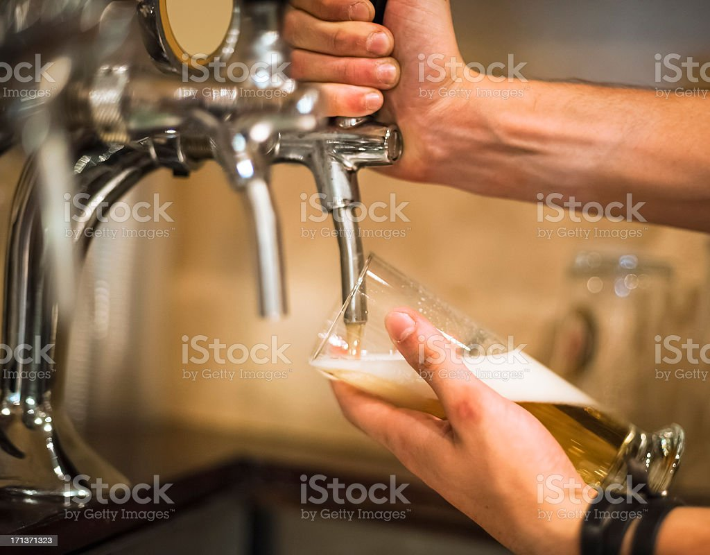 Bartender pouring beer royalty-free stock photo