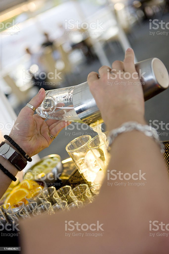 Bartender pouring cocktail stock photo