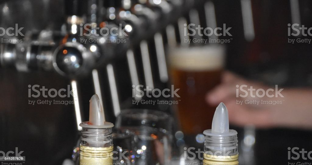 Bartender pours a beer stock photo