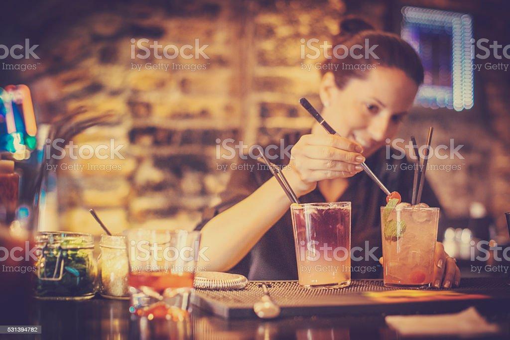 bartender preparing a cocktails stock photo
