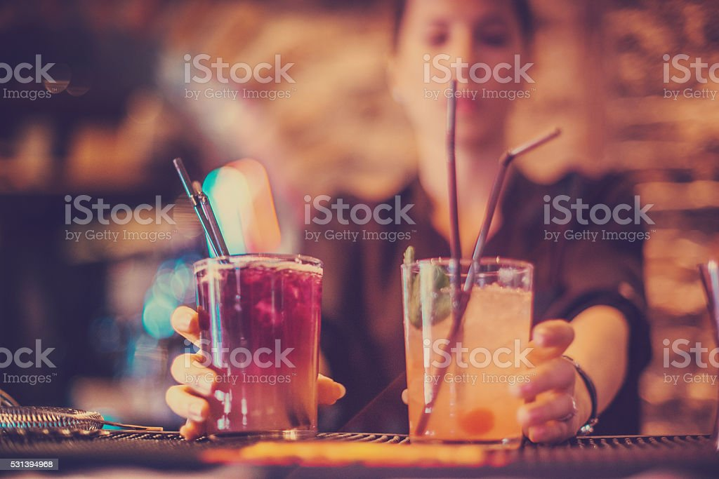 bartender preparing a cocktails stock photo