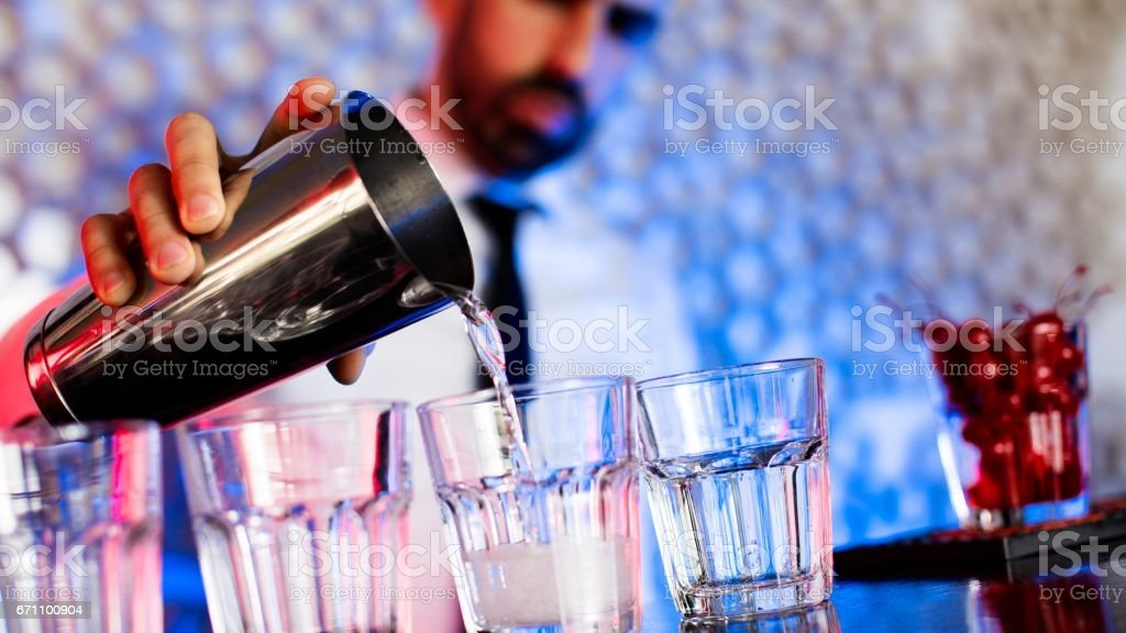 Bartender preparing cocktails in cocktail bar stock photo