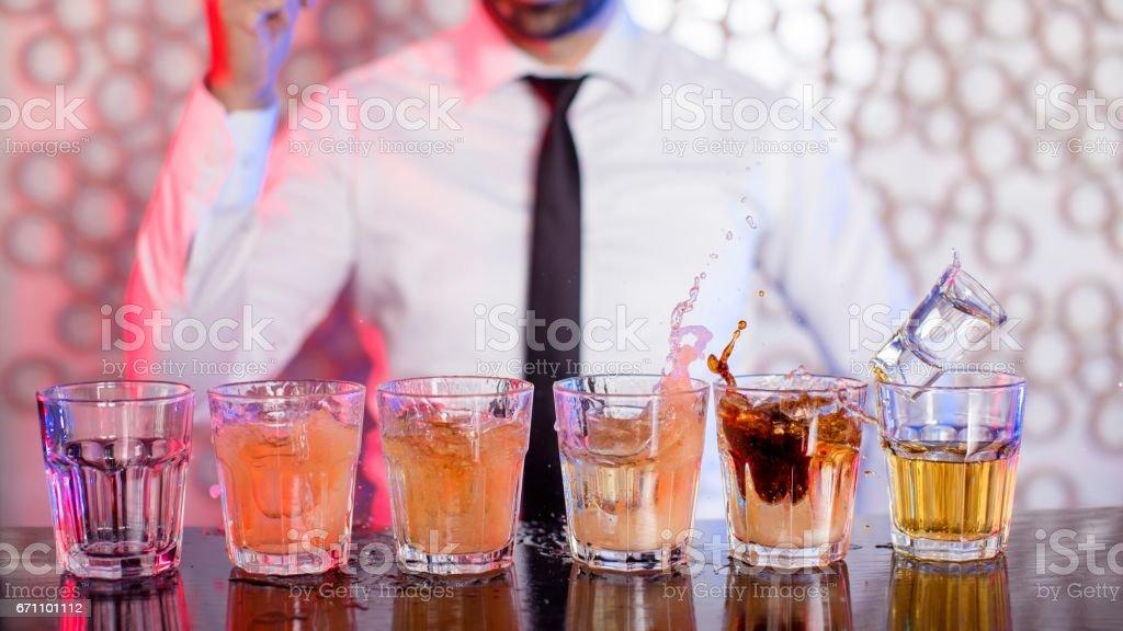 Bartender preparing cocktails stock photo