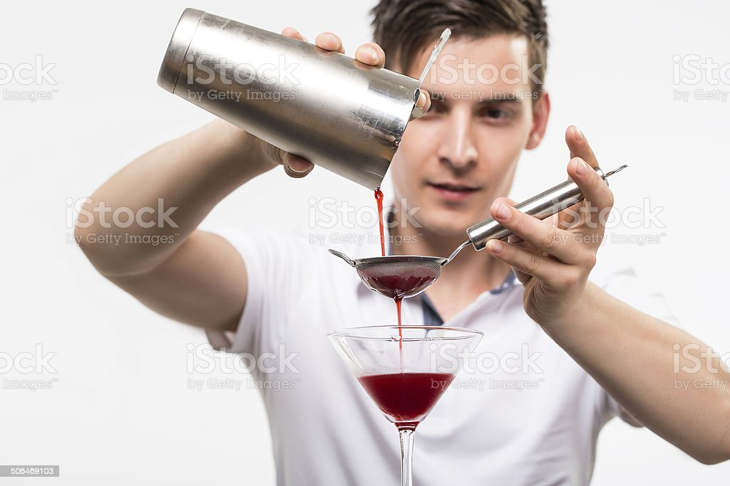Bartender preparing coctail stock photo