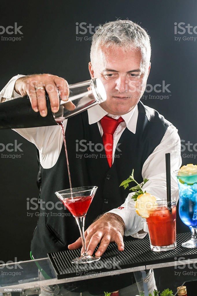Bartender preparing Cosmopolitan cocktail stock photo