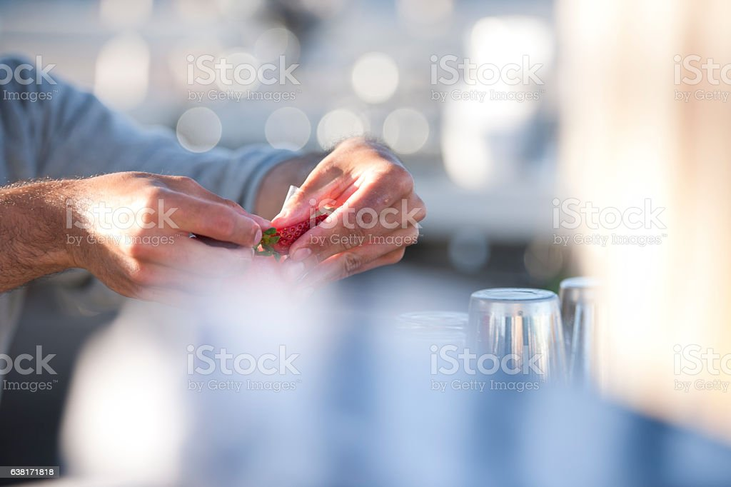 Bartender preparing fruit garnish stock photo