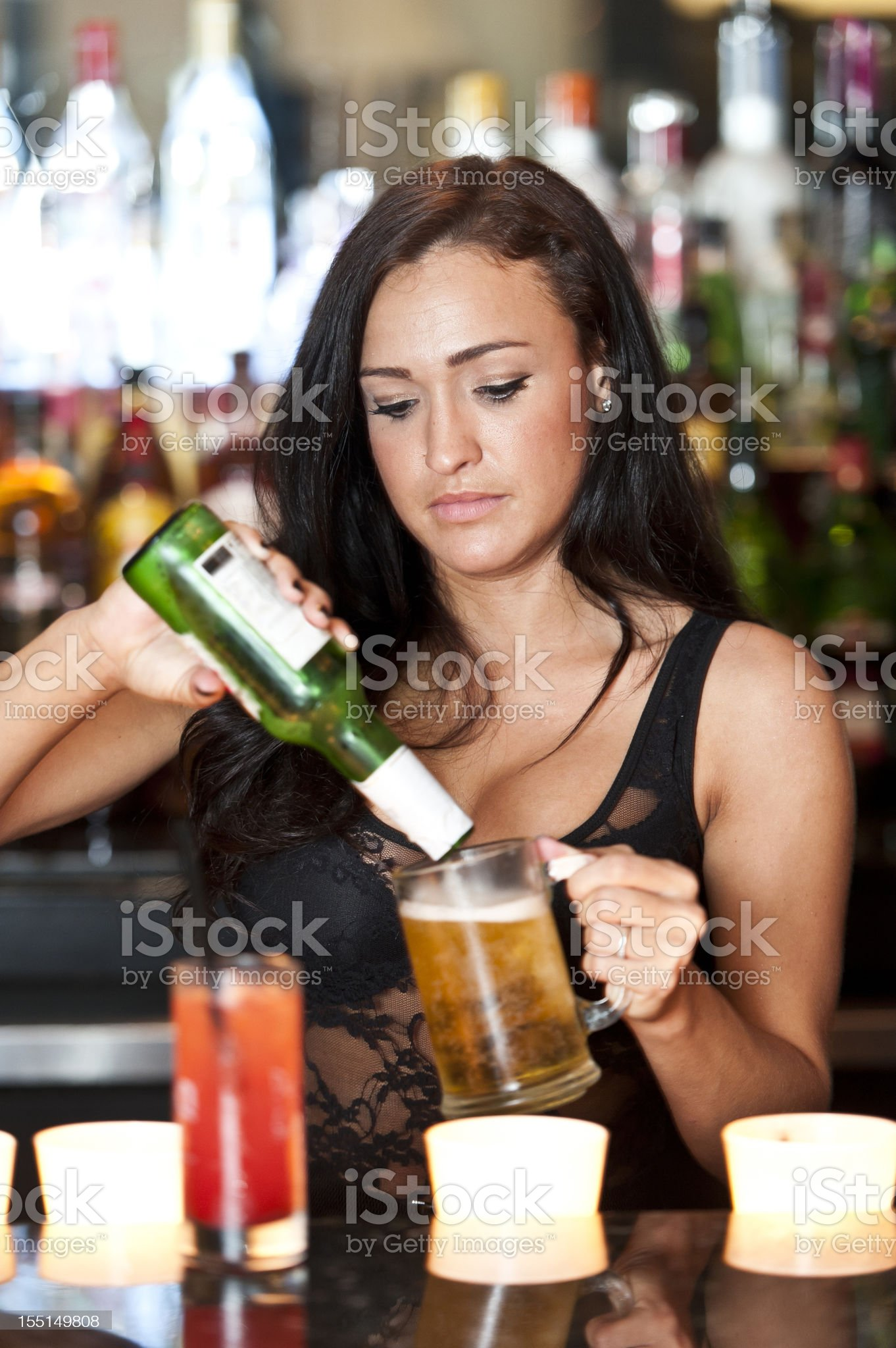Bartender serving a beer royalty-free stock photo