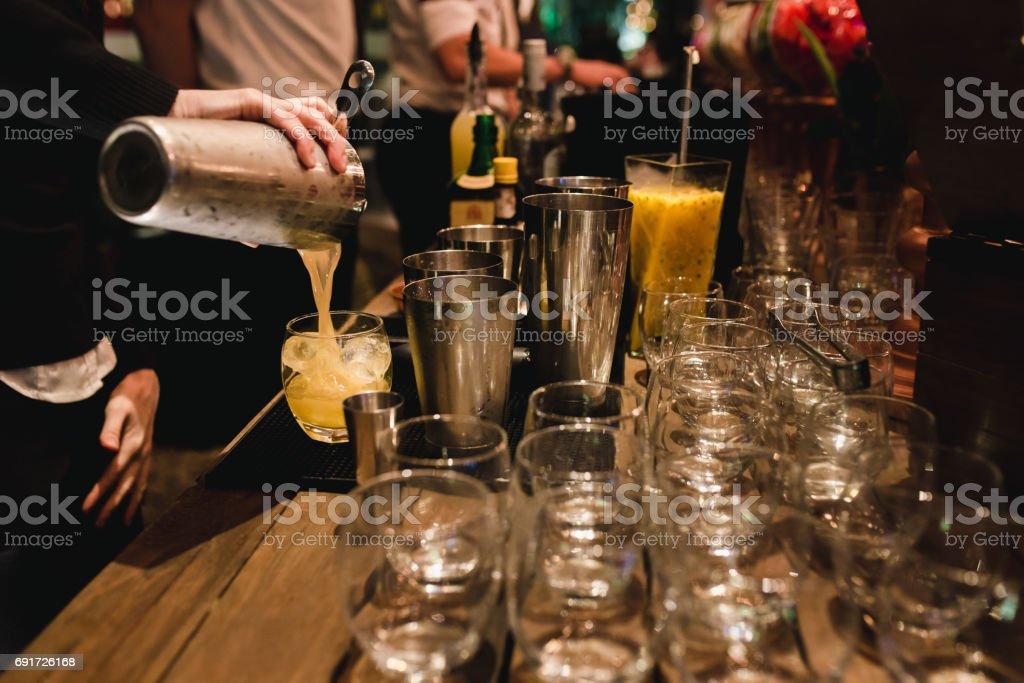 Bartender Serving a brazilian caipirinha stock photo