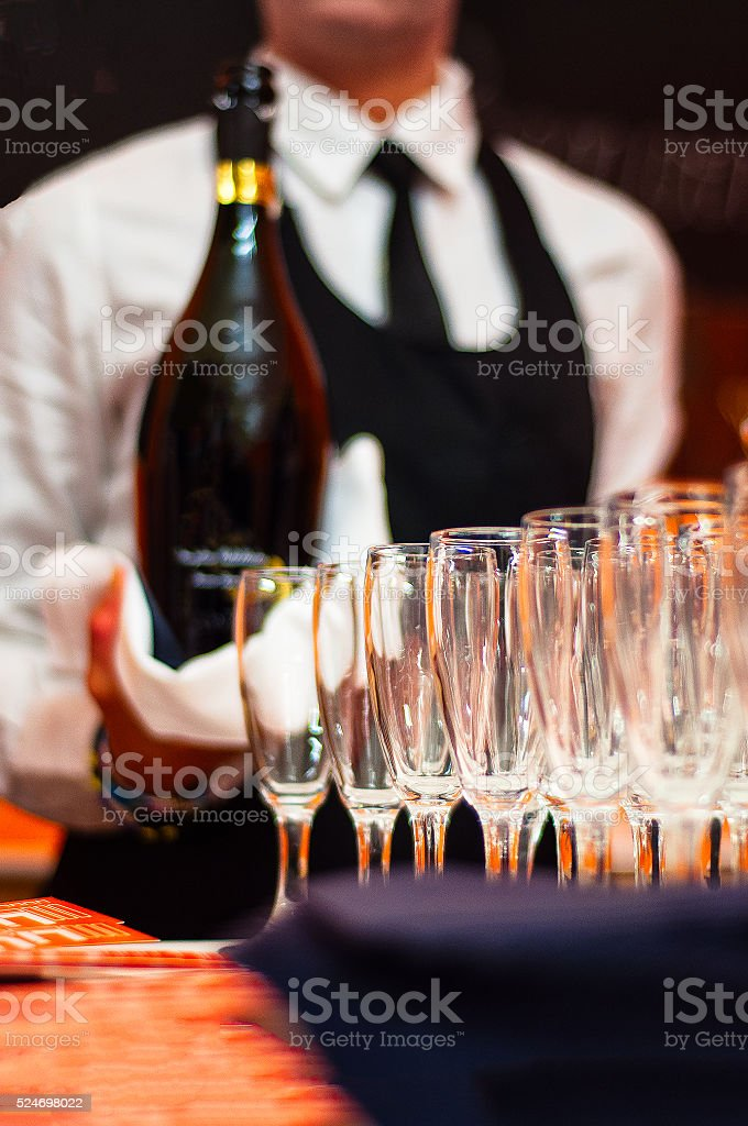 Bartender serving champagne stock photo