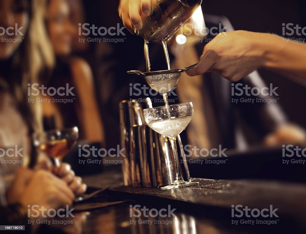 Bartender Serving Cocktail Drinks stock photo