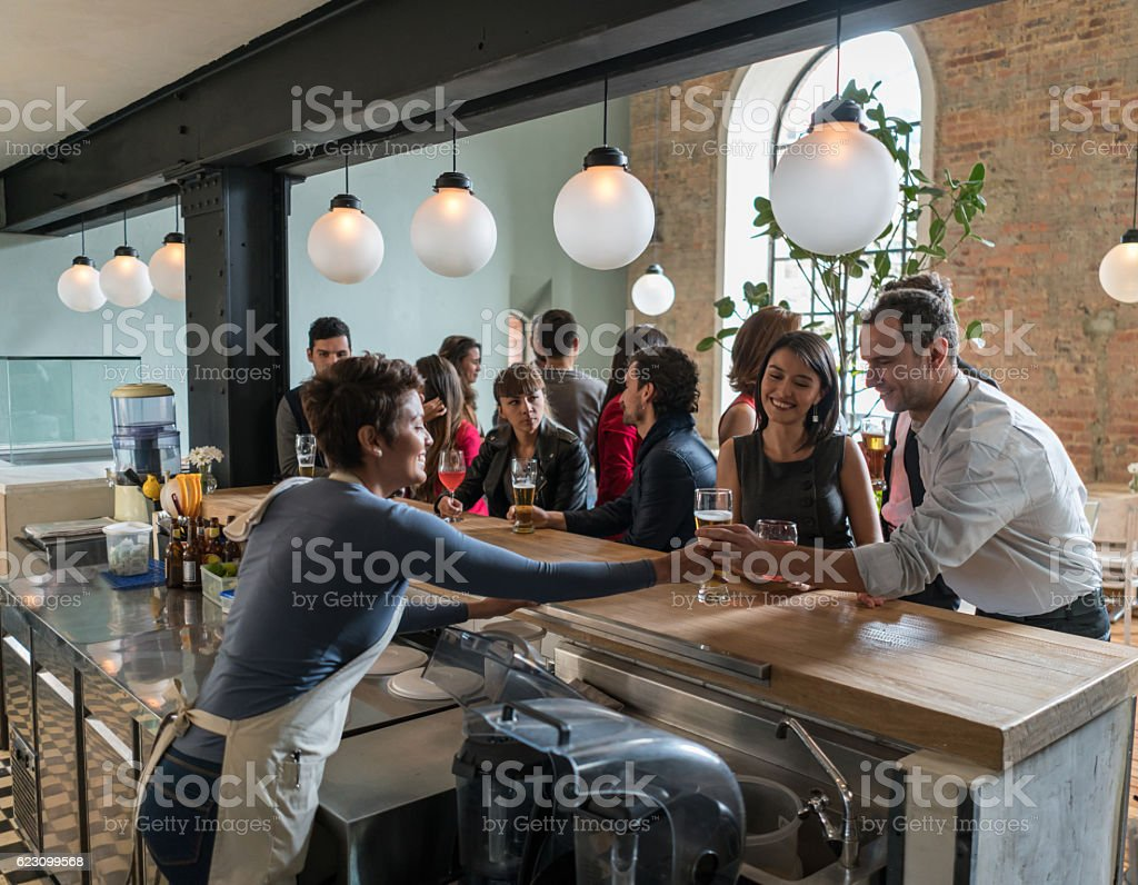 Bartender serving drinks at the bar stock photo