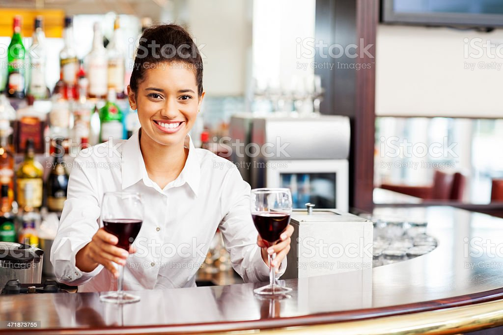 Bartender Serving Red Wine At Bar Counter royalty-free stock photo