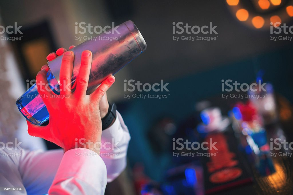 Bartender shaking cocktail stock photo