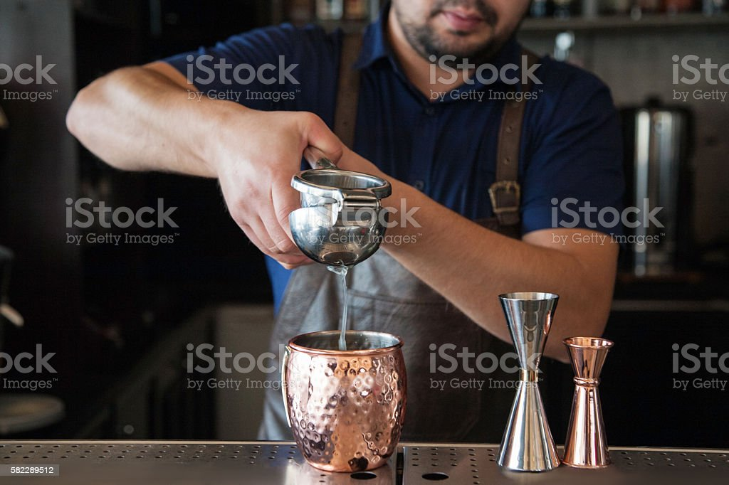 bartender squeezed juice stock photo