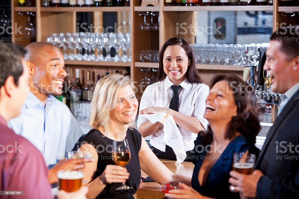 Bartender with group at bar royalty-free stock photo