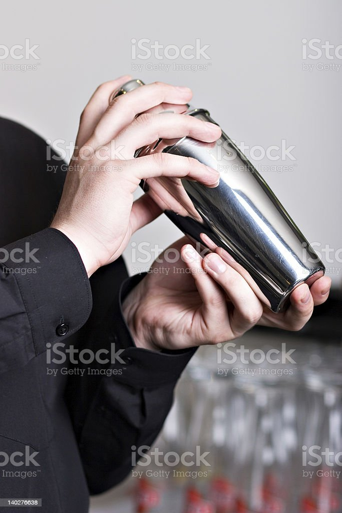 Bartender with steel shaker stock photo