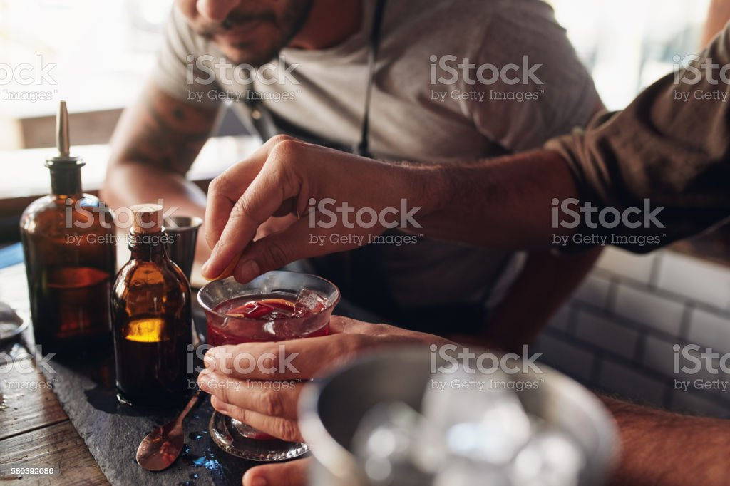 Bartenders experimenting with creating cocktail mixing ideas stock photo