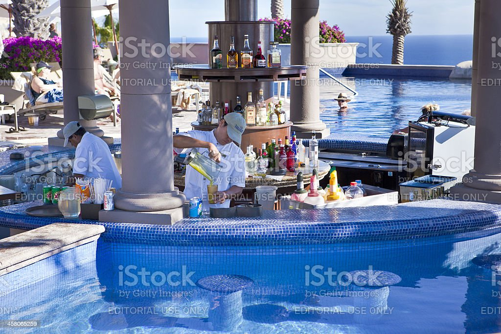 Bartenders Working a Pool Bar in Mexico stock photo