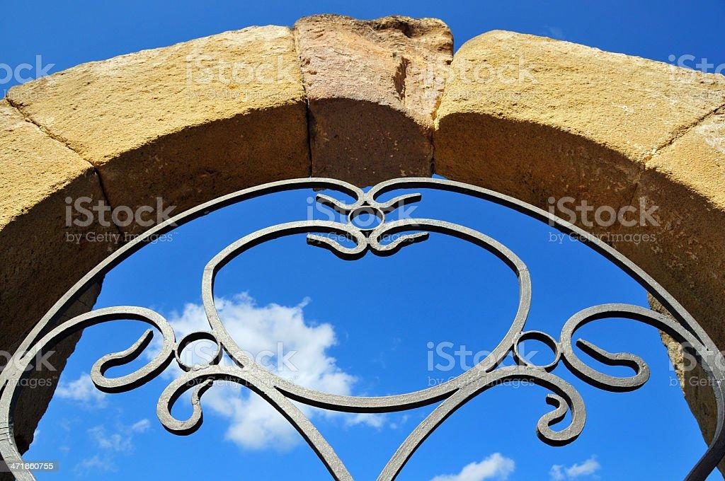 Barumini , Medio Campidano, Sardinia, Italy: Immaculate Conception Church, stone arch stock photo