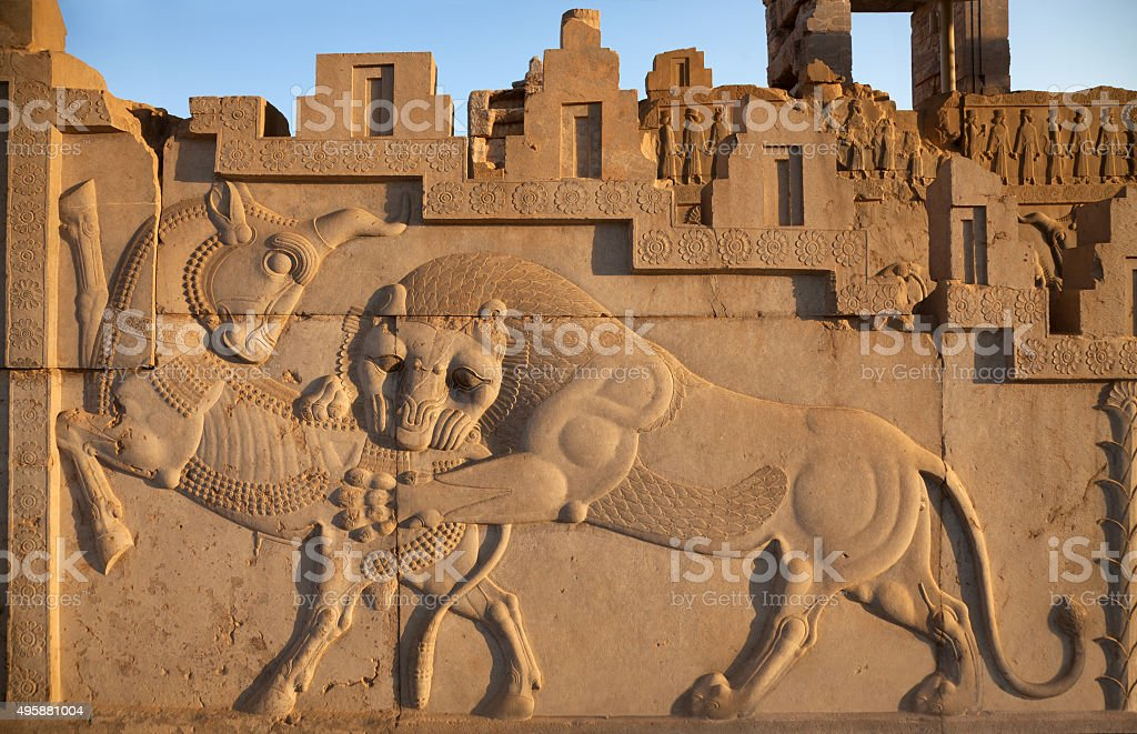 Bas Relief Carving of Lion Hunting a Bull in Persepolis stock photo