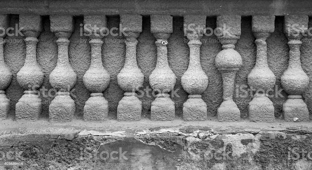 Bas relief of stone balustrade with one banister inverted stock photo