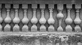Bas relief of stone balustrade with one banister inverted