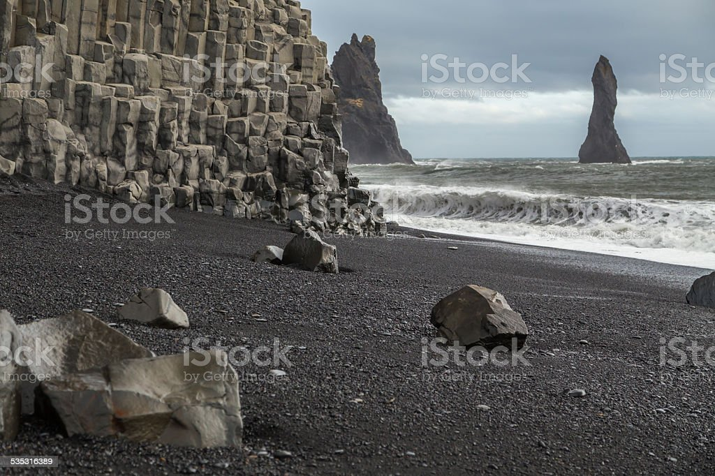 Basalt rock columns on the volcanic black beach at Vik stock photo