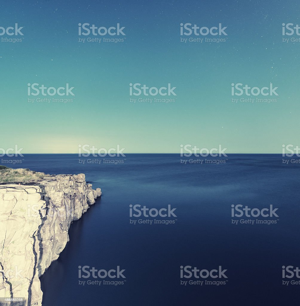 Basalt Shoreline in Moonlight stock photo