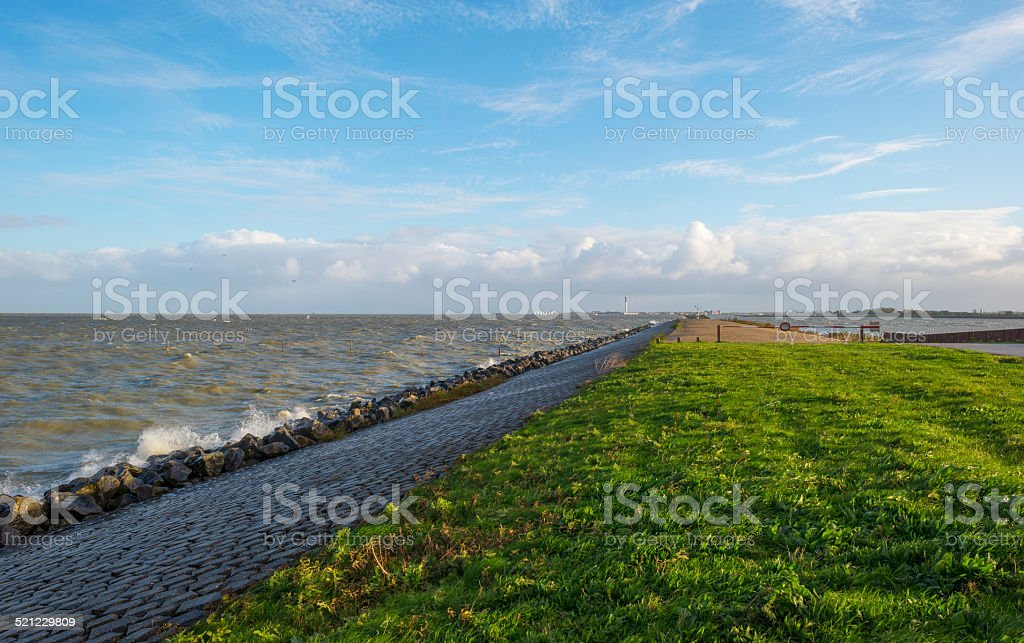 Basalt stones along a dike in a stormy sea stock photo