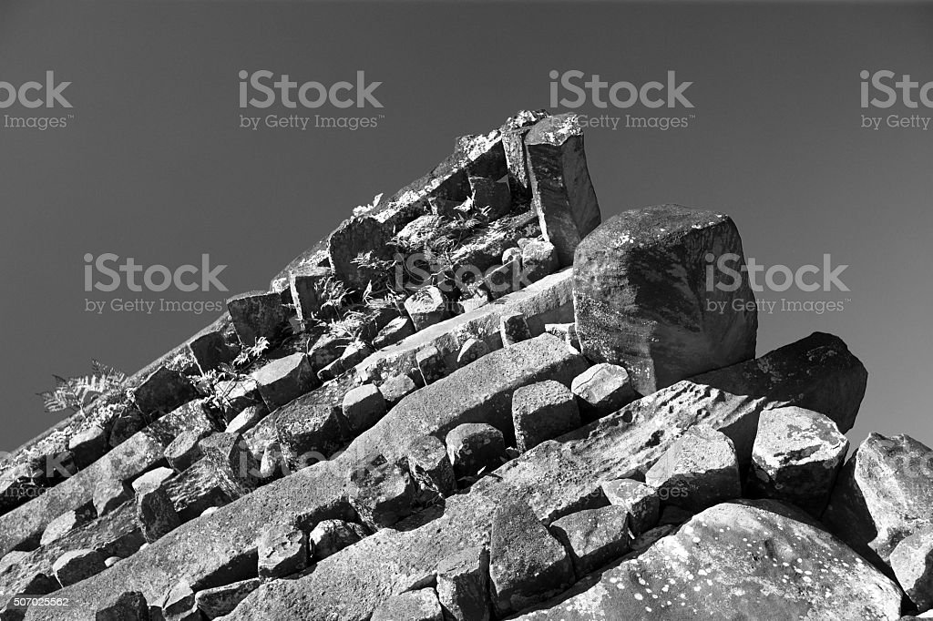 Basalt stones stacked like a house stock photo