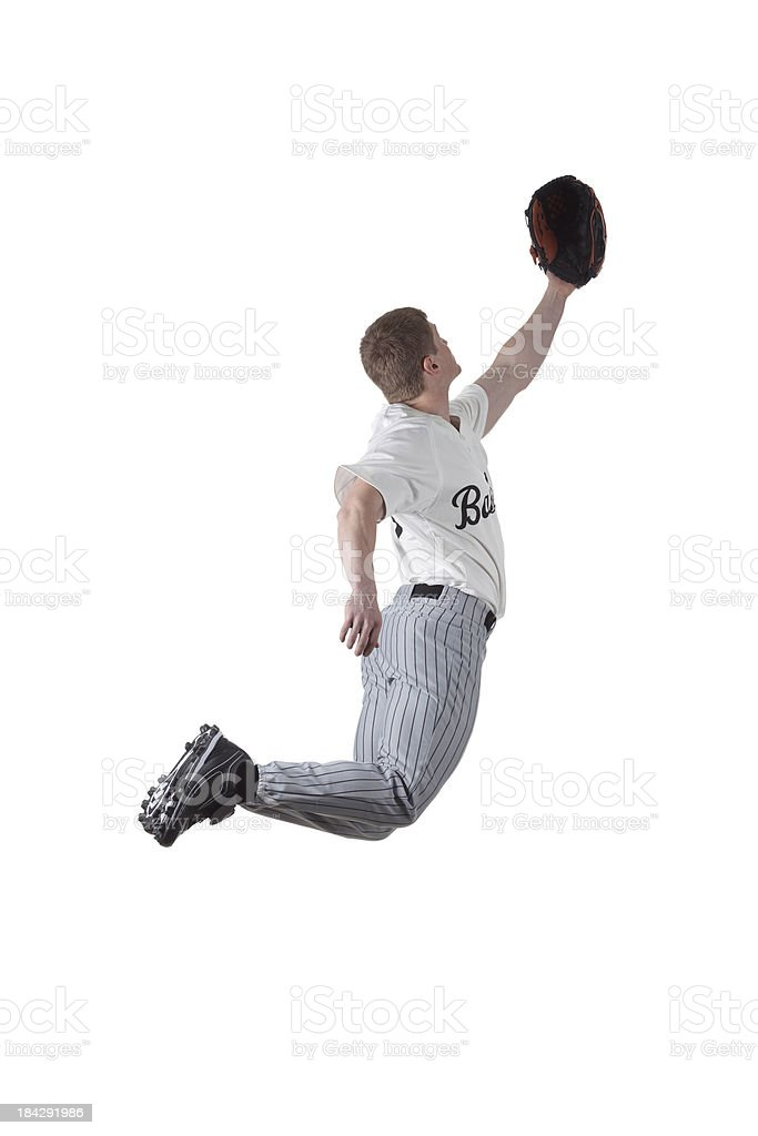 Basball player jumping to catch the ball royalty-free stock photo