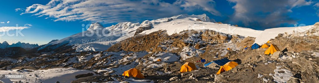 Base camp dome tents snow glacier mountain peaks panorama Himalayas stock photo
